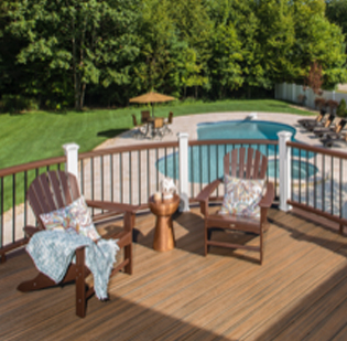 two chairs on a deck overlooking a pool